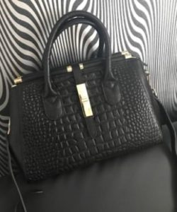 10. An embossed crocodile doctor bag for looking bougie on a budget.1