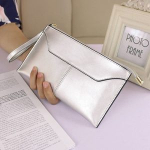 11. A metallic clutch sure to be the highlight of any outfit. It has slots built in for credit cards and bills, so you won't need to bring a wallet!