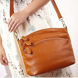 13. A small crossbody with multiple zippered pockets on the outside to keep everything organized and within reach.