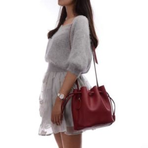 16. A drawstring bucket bag that'll look great no matter how much stuff you throw in it. It even comes with a removable pouch inside so everything stays organized.