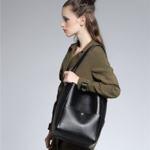 26. A bucket tote that'll sit comfortably on the shoulder and comes with many, many pockets.