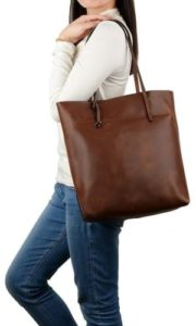 31. A roomy tote with a distressed finish that'll fit your laptop and notebooks while keeping its shape.