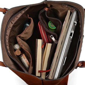 31. A roomy tote with a distressed finish that'll fit your laptop and notebooks while keeping its shape.1