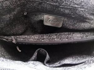 8. A tote with different compartments so you can actually find your stuff without digging through the entire thing.1